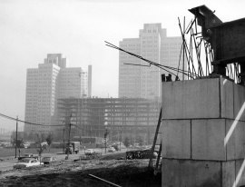The Hilton Hotel, under construction in October 1958, framed by one of the tiers leading to the new Fort Pitt Bridge. (Photo credit unknown)