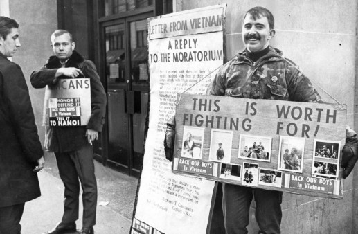 November 23, 1969: Ted Johnson, left, of Bellevue, and Bill Archer of Mt. Lebanon stand at the corner of Fifth and Smithfield to speak out for the boys in Vietnam. (Ross A. Catanza/Pittsburgh Press)