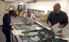 A photo washing station was set up in the platemaking department. From left, assistant managing editor Mila Sanina, head librarian Angelika Kane, photo editor Kurt Weber. (Steve Mellon/Post-Gazette)