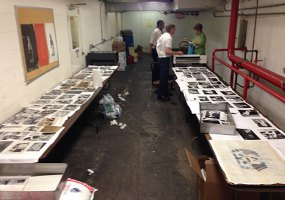Two rows of tables became the heart of the assembly line for drying photos. (Ethan Magoc/Post-Gazette)
