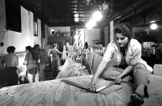 Mary Pat Donegan, president of Wild Sisters, a bar and bistro on the South Side, does some carpentry for the stage in July of 1982. (Mark Murphy/Post-Gazette)