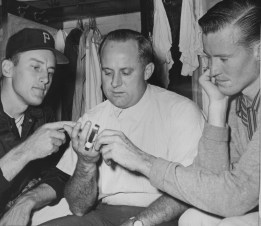 June 25, 1961: Burgess dislocated a finger against Philadelphia, but it was probably not caused by an odd grip. Injured teammates Vern Law, left, and George Witt, right. (The Pittsburgh Press)