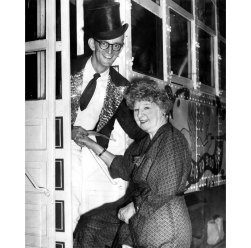 KDKA Radio personality Rege Cordic welcomes Gertrude Gordon as she boards a street car. (Pittsburgh Press photo)