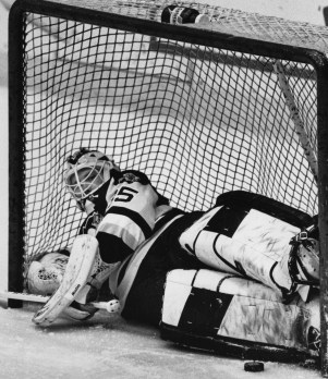 Barrasso had to retreat all the way into the net to make this first period stop against the Whalers, February, 1992, Bob Donaldson/Post-Gazette.