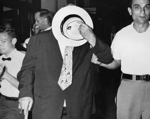 Charles Zubik peers through a hole in his Panama hat at the Allegheny County Courthouse. (Pittsburgh Press photo)