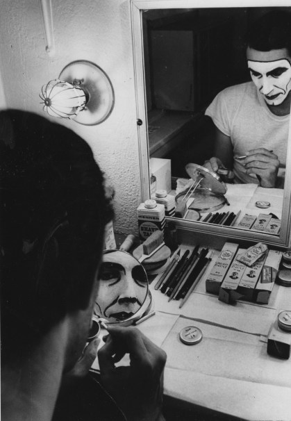 In 1973, an actor carefully applies his makeup in his dressing room at The Pittsburgh Playhouse in Oakland. (Photo by Ben Spiegel)