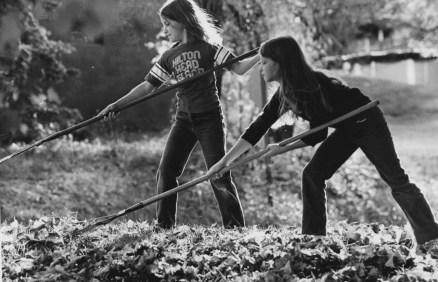 Oct. 16, 1983: Beth McElhaney, left, and Alicia Huntsinger, 9, of Bethel Park team up in their yard of leaves. (Harry Coughanour/Post-Gazette)