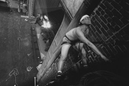 This 1991 photo shows Charles Becker hanging by a harness and working on the fire curtain above the main stage of the Byham Theater. (Darrell Sapp/Post-Gazette)