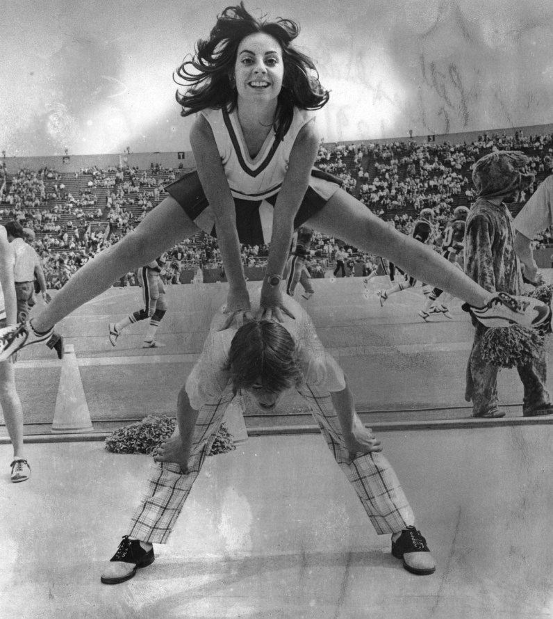 Pitt cheerleaders, Vicki Veltri and Jack McBride, perform at a game on September 9, 1974. (Andy Starnes/The Pittsburgh Press)