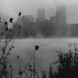 Sept. 19, 1982: The skeleton of PPG Place was the backdrop for fog on the rivers. (Harry Coughanour/Post-Gazette)