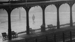 Feb. 6, 1986: Fog and mist nearly obscure a person walking on the Station Square railroad platform. (Thomas Ondrey/The Pittsburgh Press)
