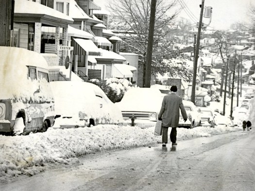 On Greenfield Avenue walking is still the best form of transportation as snow buries the cars, (Robert Pavuchak/Pittsburgh Press)