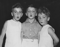 From left to right, David Fineman, Saul Pomerantz and Donald Exler demonstrate their whistling abilities during a dance carnival at the Irene Kaufmann Settlement in the Hill District. The picture was taken in August of 1940.