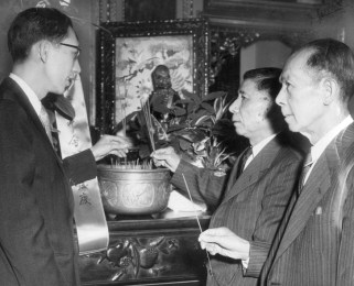 April 21, 1959: From left, Yee Yuen, owner of Chinatown Inn, Sam George, president of On Leong's Pittsburgh chapter, and William Yot, mayor of Chinatown, offer joss sticks to their ancestors at the 55th convention of the On Leong Chinese Merchants Association.