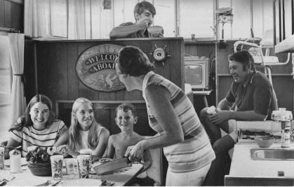 Mrs. Tyler serves lunch to her children aboard the Tippecanoe III.