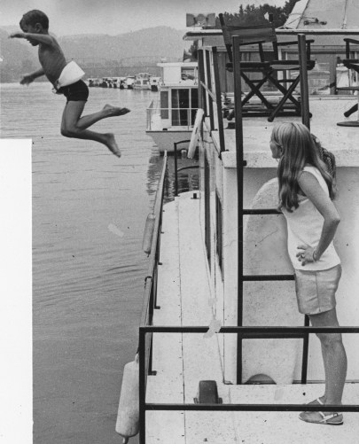 Loran Tyler, age 5, enjoys a dive from the Tippecanoe III into the Allegheny River.