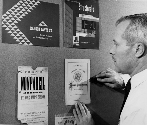 Harold Gardner of W.G. Johnston, Co., one of Pittsburgh's oldest printers when this image was published in 1960, shows off designs from as early as 1840. (Post-Gazette)