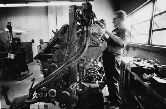 Linotype operator and 40-year industry veteran Carl Heinsl examines his machine in 1986. (Thomas Ondrey/The Pittsburgh Press)