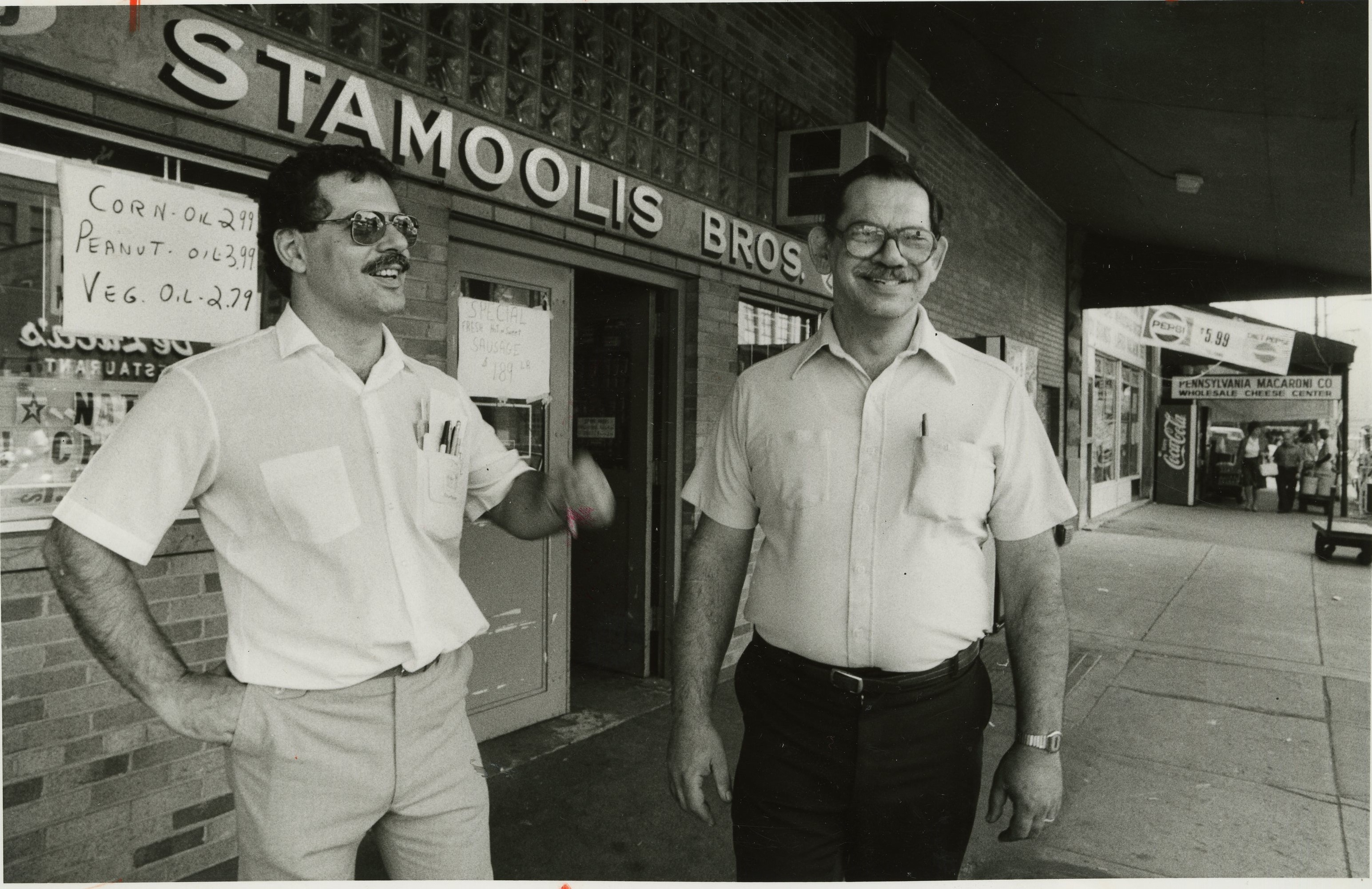 Pete and Gus Stamooli stand in front of Stamooli Brothers in the Strip on this October day in 1986. (John Sale/The Pittsburgh Press)