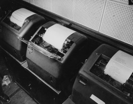 May 27, 1957: A row of teletype machines at The Pittsburgh Press office.