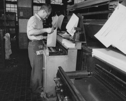 May 27, 1957: An employee loads the proof machine inside the composing room at The Pittsburgh Press office.