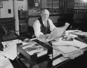 January 1957: An editor sits in his office at The Pittsburgh Press. Out the window, parts of what would become Gateway Plaza are visible.