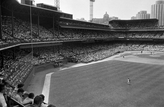 Roberto Clemente is in right field as the Pirates take the first game against the Giants, 7-4.