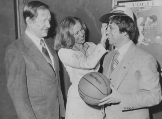 Pitt Athletic Director Cas Myslinski, left, along with Roy Chipman, right, and Chipman's wife, Kathi, after Roy Chipman was named Pitt's new men's basketball coach. (Post-Gazette)