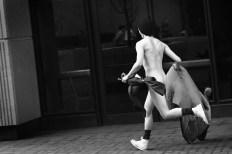 Streaker then bolts across campus. (Morris Berman/Post-Gazette)