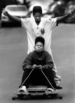 Freed from classes, Gene Frederick, 13, at the controls of his go-cart, and William Coffey, 11, took to the slopes of Coal Street in 1991. (Emiko Mochizuki/The Pittsburgh Press)