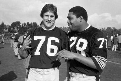 Steelers defenders John Banaszak (left) and Dwight White. (Albert M. Herrmann Jr./The Pittsburgh Press)