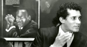 Tim Stevens with the portrait of Martin Luther King in the background at the Hill House Center (Jan. 17, 1988, The Pittsburgh Press)