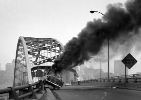 Smoke rises over the bridge. (Morris Berman/Post-Gazette)