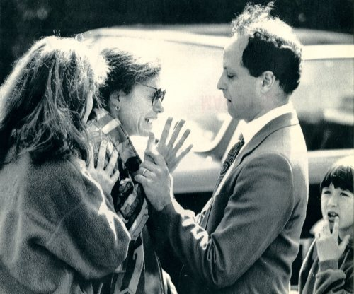 Rebecca Becker Rutenberg whose son was burned as a result of the crash is comforted outside the school where air-crash wreckage fell, Apr. 4, 1991