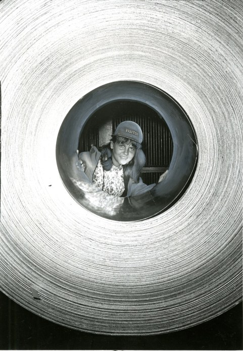 Framed by steel coil during her visit to Irvin Works of U.S. Steel Corp. is Alida Montalti.