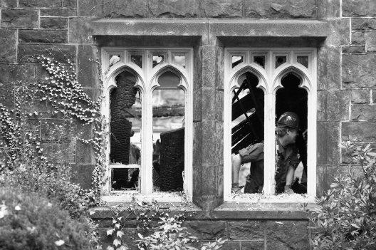 Investigators seen through church windows. (Steve Mellon/The Pittsburgh Press)