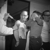 A man gets a shot in April 1964.
