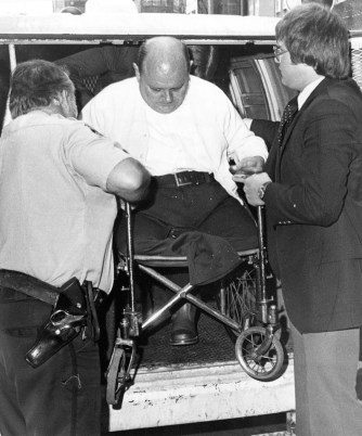 Grady Stiles Jr. is assisted from a van enroute to the coroner's hearing. Published Oct. 7, 1978.
