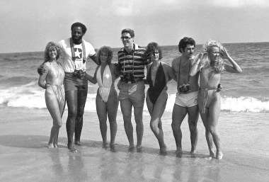 "Cowboy Ed ""Too Tall"" Jones (second from left) with friends on the beach. (Morris Berman/Post-Gazette)"