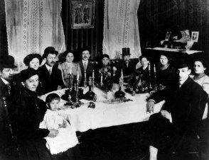 The Rudick family, immigrants from Romania, participate in a seder a century ago.