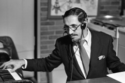 Musical director Johnny Costa at his piano and celesta in the WQED studio. Johnny and the other musicians played live for every taping of Mister Rogers Neighborhood. Costa served as musical director for the show until his death in 1996. Costa, son of Italian immigrants, was already a highly respected Jazz musician when Rogers hired him.