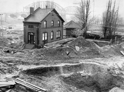 Days were numbered for the custodian's house on March 7, 1965, during construction of recreation of Fort Pitt.