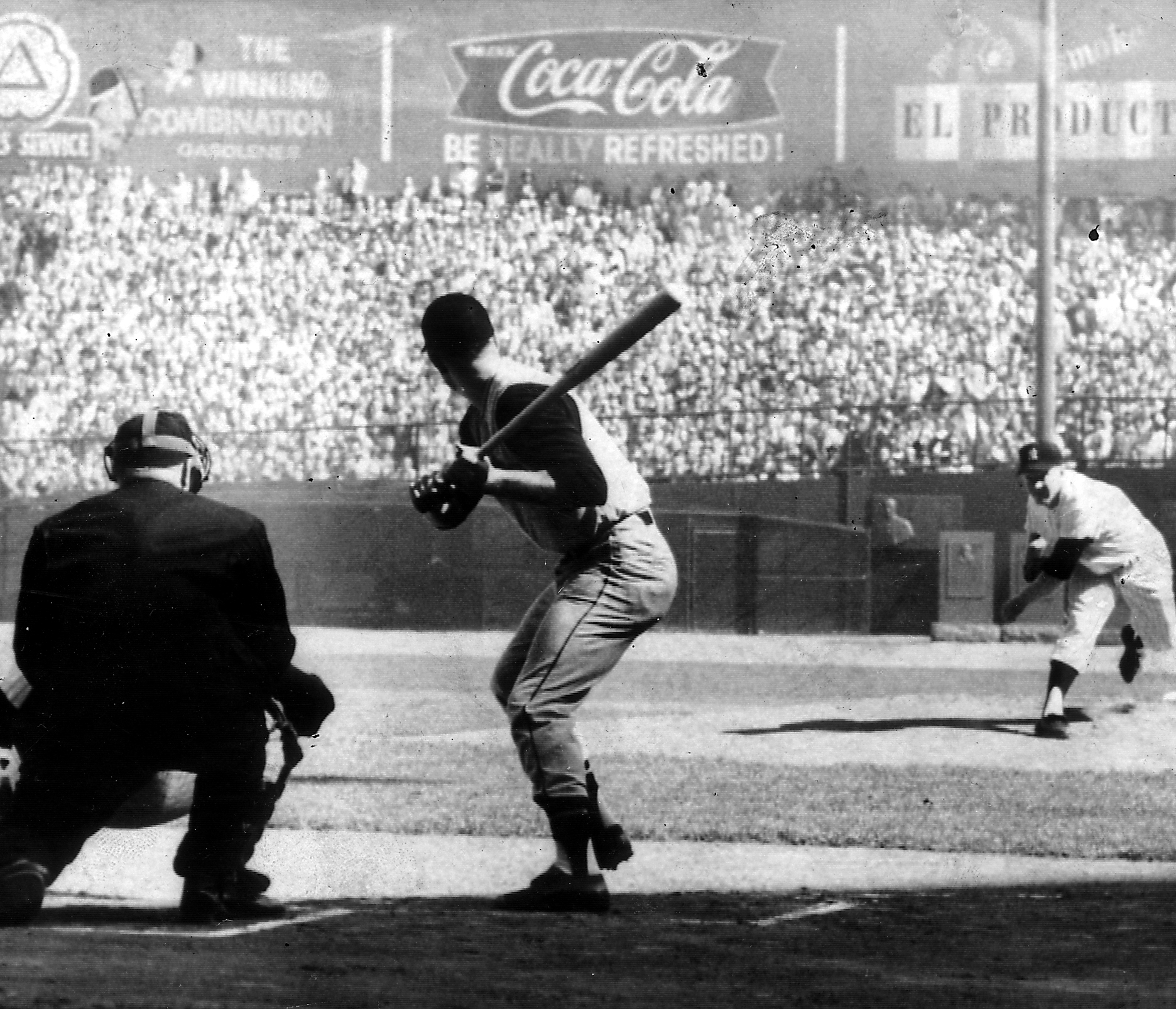 First pitch from Yankee pitcher Whitey Ford comes at Pirate center fielder Bill Virdon in the third World Series game at Yankee Stadium.
