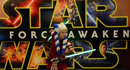 """Cathy McCrohan, 25, of Millvale, strikes a pose for """"Star Wars"""" fans prior to the showing of """"Star Wars: The Force Awakens"""" at AMC in Homestead on Thursday, December 17, 2015. (Lake Fong/Post-Gazette)"""