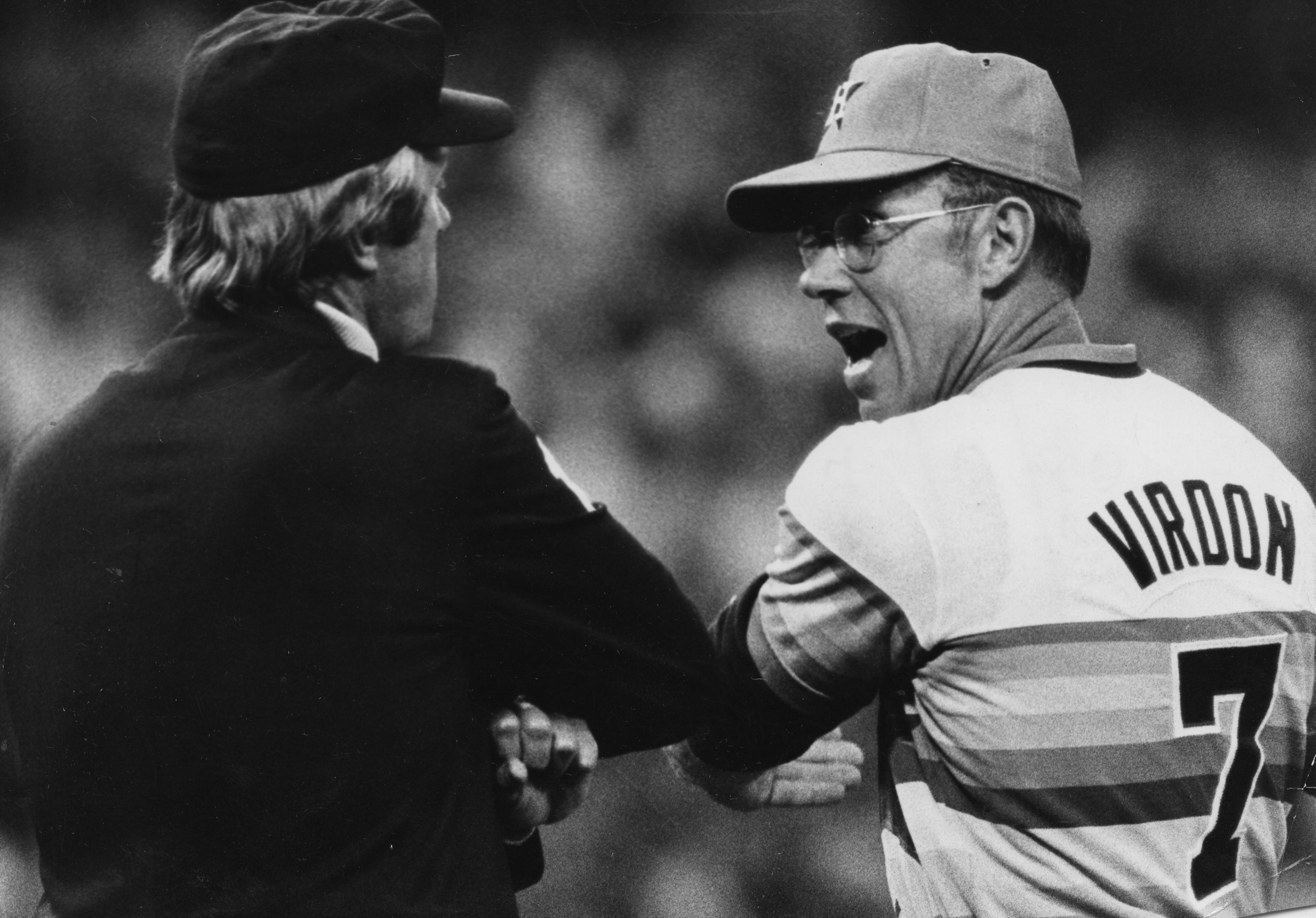 Bill Virdon has a spirited conversation on the diamond while coaching the Houston Astros.
