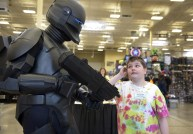 "Mark Hoag of Ambridge, dressed as a a Republic commando from ""Star Wars,"" greets Hunter Bolyard, 11, of Morgantown, W.Va., during Steel City Con Friday at the Monroeville Convention Center on April 5, 2013. (Julia Rendleman/Post-Gazette)"