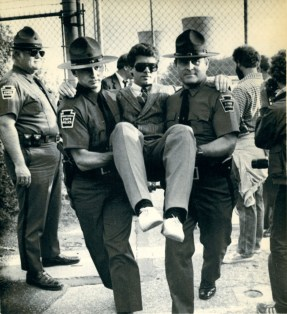 An anti-Three Mile Island protestor blocking the front gate of the plant is carried away by state police and arrested near Middletown, Pa. Demonstrators were protesting the Nuclear Regulatory Commission's 1985 decision to restart the undamaged TMI Unit 1 reactor. (Associated Press)
