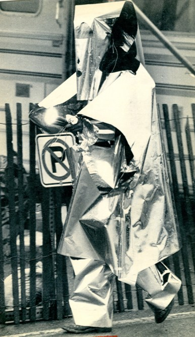 A Three Mile Island employee enters the facility wearing one of the metal decontamination suits personnel had to wear when working near the crippled reactor. (Associated Press)