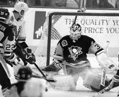 Tom Barrasso makes a save against the Minnesota North Stars in game six of the 1991 Stanley Cup victory. (Darrell Sapp/Post-Gazette)