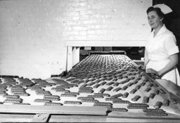 Clark bars move down a conveyor belt to be wrapped and packaged for shipment throughout the world. Picture published June 15, 1961. (Pittsburgh Press)